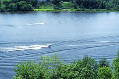 The Connecticut River in East Haddam Connecticut. Boaters on Connecticut River flowing through East Haddam near Gillette Castle State Park in New London County stock images