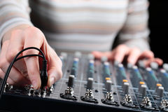 Connecting Cable to Audio Mixer stock images