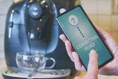 Connecting coffee machine with smart phone stock image