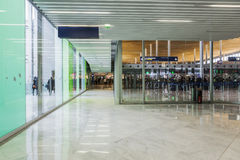 Connecting corridor in green glass hall. Stock Photo