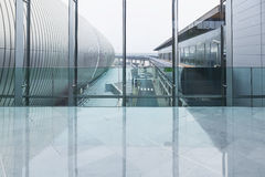 Connecting corridor in green glass hall. Stock Photos