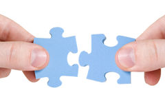 Connecting different pieces of puzzle Stock Photography