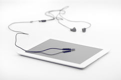 Connecting Earphones Stereo Jack To Tablet Device Stock Images