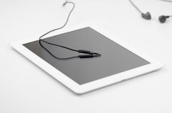 Connecting Earphones Stereo Jack To Tablet Device Stock Photos