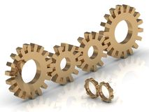 Connecting the four gold and two small gears Stock Photography