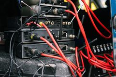 Connecting microphones. Base for microphones with connected red wires. Microphones and radio systems. Musical equipment at a royalty free stock photography