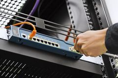 Connecting Network Cable to Switch Stock Photo