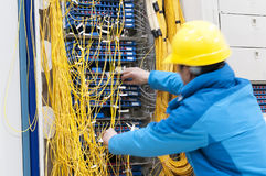 Connecting network cables to switches Royalty Free Stock Photos