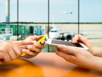 Connecting our smartphones at the airport Stock Photos