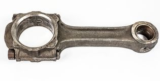 Connecting rod from a car engine. Isolated on white.  stock photography