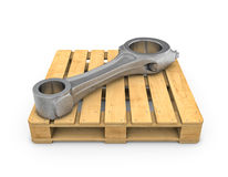 Connecting rod on wooden pallet on white backgound Stock Image