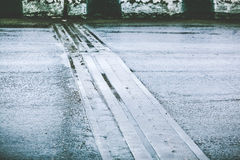 Connecting structure of bridge on wet asphalt road Stock Photography