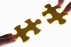 Connecting two piece of jigzaw puzzle Stock Images