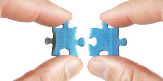 Connecting two puzzles. Stock Image