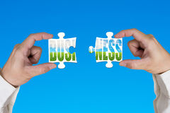 Connecting two puzzles for green business Royalty Free Stock Photo