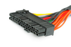 Connecting wires to a computer on a white. Background Stock Photography