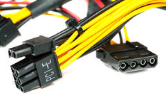 Connecting wires to a computer on a white Royalty Free Stock Photos