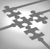 Connection Direction. As a business concept of a group of roads or highways shaped as jigsaw puzzle pieces connecting together as a team partnership bridging Stock Images