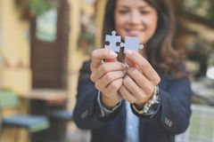 Connection focus on hands trying make a puzzle. Young woman Stock Image