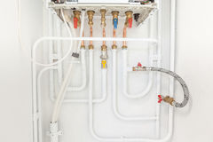 Connection of heating and hot water Stock Image