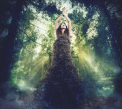 Connection between nature and human. Woman dressed in branches in the woods. connection between nature and human concept stock photos