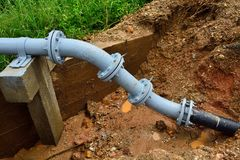 Connection plumbing to underground in rural. Royalty Free Stock Photos
