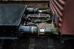 Connection between two railway wagons on a railway track Stock Photo