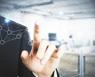 Connectivity concept. Businessman pointing at abstract polygonal network on blurry office interior background. Connectivity concept. 3D Rendering royalty free illustration
