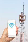 Connectivity concept: Free wifi area sign on phone screen Stock Photos