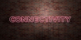 CONNECTIVITY - fluorescent Neon tube Sign on brickwork - Front view - 3D rendered royalty free stock picture Royalty Free Stock Photos