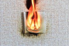 . connector. due to the closure burned out. close-up. the fire is burning it& x27;s real royalty free stock photo
