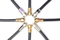 Connectors. Professional cable tv connectors against bright background Stock Photos