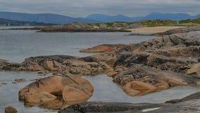Connemara beach. The ocean washes boulders on the rugged Connemara coastline Royalty Free Stock Photo