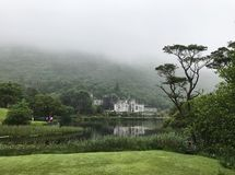 Kylemore Abbey Castle in Connemara County Galway Ireland. Connemara, Ireland – Jun 17, 2017: Kylemore Abbey is a Benedictine monastery founded in 1920 on royalty free stock images