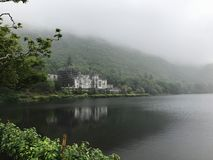 Kylemore Abbey Castle in Connemara County Galway Ireland. Connemara, Ireland – Jun 17, 2017: Kylemore Abbey is a Benedictine monastery founded in 1920 on royalty free stock photos