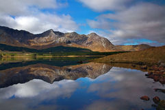 Connemara National Park, Ireland. Mountains reflection in clear, quiet lake Royalty Free Stock Images