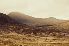 Connemara mountains in Ireland in fog. Connemara is a district in the west of Ireland of which the boundaries are not well defined. Some define it to be the land Royalty Free Stock Photo