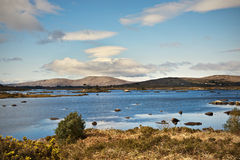 Connemara mountains and lake in Ireland. This is summertime view for lake in Connemara Mountains in Ireland. Connemara is a district in the west of Ireland of Royalty Free Stock Image