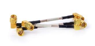 Connettori ad alta frequenza di SMA su fondo bianco oro Fotografia Stock Libera da Diritti