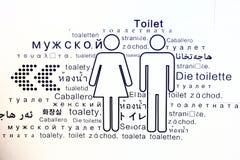 Connexion de toilette de toilettes beaucoup langue Photos libres de droits