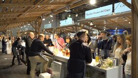 Connoisseurs of alcohol tasting wine during the food fair. HELSINKI, FINLAND - MARCH 18,2018: Connoisseurs of alcohol tasting wine during the Show Gastro stock video