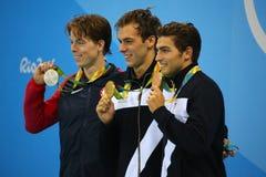 Connor Jaeger L США, чемпион Gregorio Paltrinieri и Gabriele Detti Италии во время 1500 фристайла метров представления медали Стоковое Фото