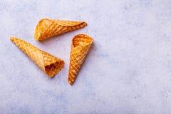 Cono de helado de la galleta en un fondo ligero Fotografía de archivo libre de regalías