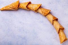 Cono de helado de la galleta en un fondo ligero Foto de archivo libre de regalías