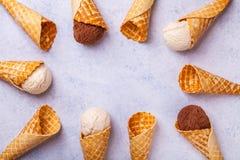 Cono de helado de la galleta en un fondo ligero Fotos de archivo libres de regalías