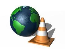 Cono del tráfico y globo del mundo Fotos de archivo