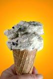 Cono di gelato sull'arancio Fotografia Stock