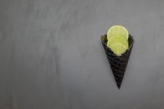 Cono gelato nero con calce Immagine Stock Libera da Diritti