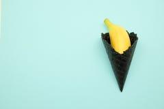 Cono gelato nero con la banana Immagini Stock