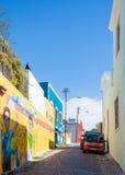 Conocen a BO-Kaap en Cape Town para su casa brillantemente pintada Foto de archivo libre de regalías